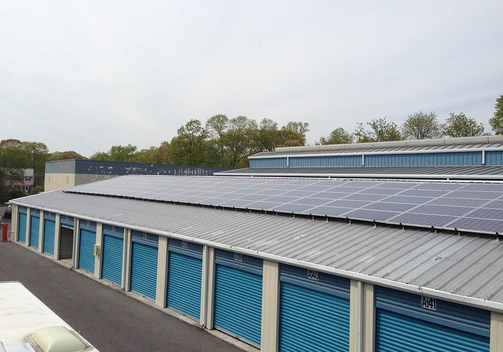 Roof-mounted solar panels on a commercial business building